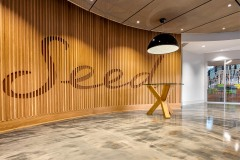 Our front lobby features rich woods, plus a stunning Skygarden lamp and a hand-painted cement floor that reflects like the top of a lake as the sun sets—evoking a natural elegance that brings Seed's equity to life.